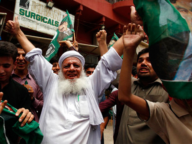 Opposition party supporters celebrate following the announcement of the Supreme Court's disqualification of Prime Minister Nawaz Sharif in Rawalpindi, Pakistan, on Friday. AP