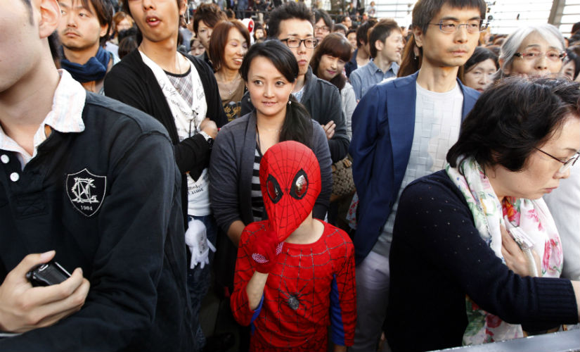 A child in Tokyo wearing a Spider-Man costume. Reuters