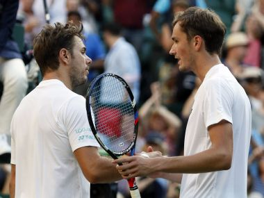 Daniil Medvedev, right, at the net after winning his against Stan Wawrinka. AP