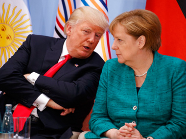 US president Donald Trump, left, talks with German chancellor Angela Merkel at the G20 Summit in Hamburg. AP