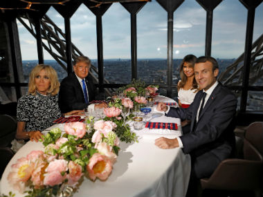 Brigitte Macron (left), wife of French President Emmanuel Macron (right), US president Donald Trump (second left) and First Lady Melania Trump pose at their table at the Jules Verne restaurant. Reuters