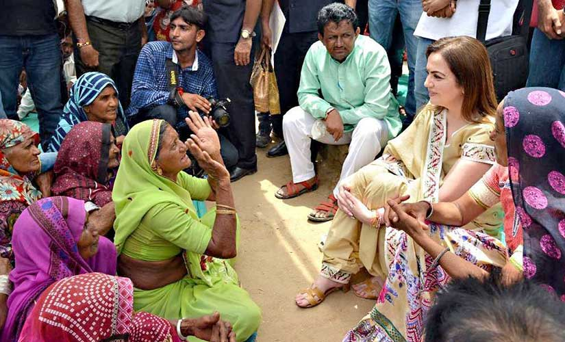 Reliance Foundation chairperson Nita Ambani interacts with flood-affected villagers in Banaskantha. Twitter @ ril_foundation