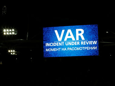 Soccer Football - Cameroon v Chile - FIFA Confederations Cup Russia 2017 - Group B - Spartak Stadium, Moscow, Russia - June 18, 2017 A message is displayed on the big screen while Chile's Eduardo Vargas' goal is reviewed by the VAR and later disallowed REUTERS/Carl Recine - RTS17LEC