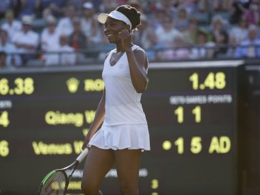 Venus Williams of the United States celebrates after winning the Women's Singles Match against China's Qiang Wang on day three at the Wimbledon Tennis Championships in London Wednesday, July 5, 2017. (AP Photo/Alastair Grant)