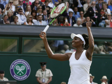 Venus Williams of the United States celebrates after beating Britain's Johanna Konta in the Women's Singles semifinal match on day nine at the Wimbledon. AP