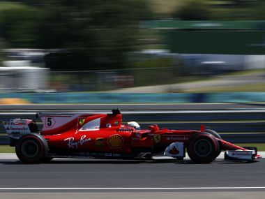 Ferrari driver Sebastian Vettel of Germany steers his car during the third free practice session for the Hungarian Formula One Grand Prix, at the Hungaroring racetrack in Mogyorod, northeast of Budapest, Saturday, July 29, 2017. The Hungarian Grand Prix will be held on Sunday, July 30. (AP Photo/Darko Bandic)