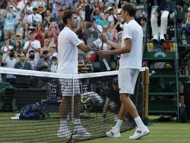 Daniil Medvedev (R) shakes hands with Stan Wawrinka after winning their first round. AFP