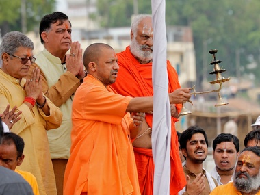 "Yogi Adityanath, Chief Minister of India's most populous state of Uttar Pradesh, holds a traditional lamp as he performs prayers called ""Aarti"" on the banks of river Sarayu in Ayodhya, India, May 31, 2017. REUTERS/Pawan Kumar - RTX38BJC"