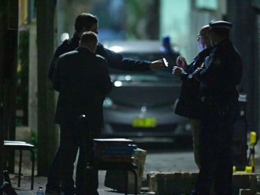Australian Federal Police and NSW Police officers work in the Surry Hills suburb of Sydney, Australia. AP