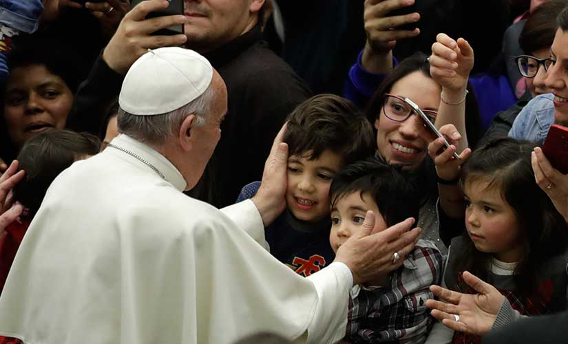 In this file image, Pope Francis greets children from the Vatican's Bambino Gesu Pediatric Hospital. AP