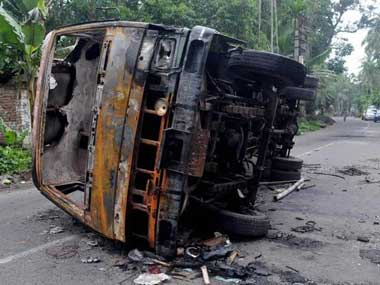 A charred vehicle is seen during the riots in Baduria, West Bengal. PTI