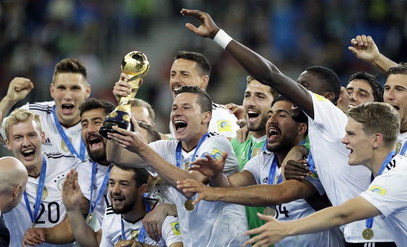 Germany's Julian Draxler holds aloft the trophy after winning the Confederations Cup final on Sunday. AP