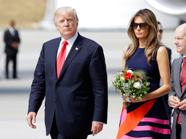 U.S. President Donald Trump and his wife Melania are accompanied by Hamburg mayor Olaf Scholz, right, after arriving for the G-20 summit in Hamburg, Germany. AP
