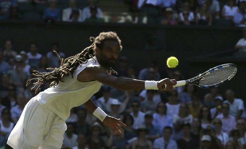 Germany's Dustin Brown returns to Britain's Andy Murray during their Men's Singles Match on day three at Wimbledon. AP