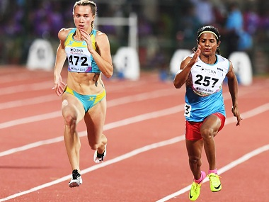 Dutee Chand participates in the women's 100m run heat during the first day of the 22nd Asian Athletics Championships. AFP