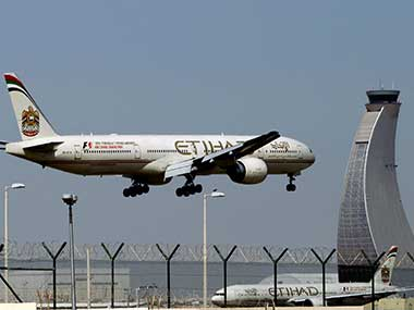 An Etihad Airways plane prepares to land at the Abu Dhabi airport in the United Arab Emirates. AP