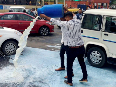 OBC leader Alpesh Thakor throws milk on road during a farmers agitation in Ahmedabad on Wednesday. PTI