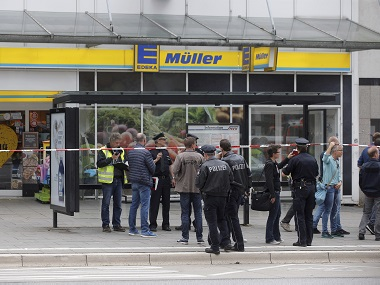 Police officers stand in front of the supermarket in Hamburg, Germany. AP
