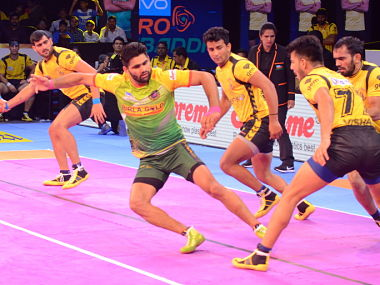 Patna Pirates' Pardeep Narwal escaping after getting a touch on a Telugu Titans player as Rahul Chaudhari watches on. PKL