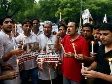 Youth Congress activists raise slogans and light the candles during a protest to condemn the militant attack on a bus in which seven Amarnath pilgrims were killed and 19 others injured, in New Delhi on Tuesday. PTI