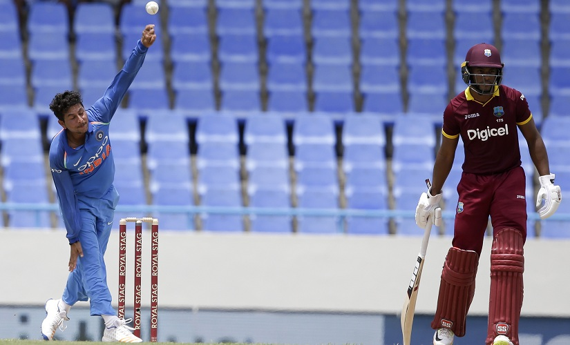 Kuldeep Yadav bowls against West Indies during the fourth ODI. AP