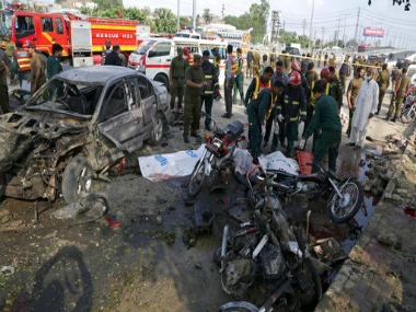 File image of Pakistani rescue workers removing a body from the site of bombing in Lahore. AP