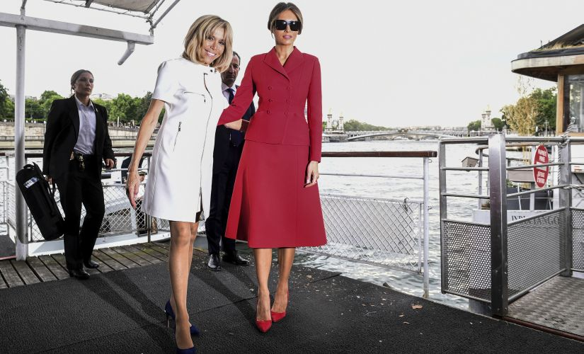 US First Lady Melania Trump and French First Lady Brigitte Macron leave after a boat trip down the River Seine in Paris. AP