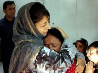 Jammu and Kashmir chief minister Mehbooba Mufti consoles an injured Amarnath pilgrim who survived the Anantnag militant attack, before she was airlifted to New Delhi at the airport in Srinagar on Tuesday. PTI