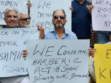 Kashmiri people hold placards during a protest against the militants attack on Amarnath Yatri bus, in Srinagar on Tuesday. PTI