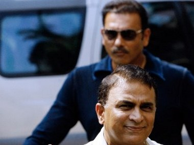 """Former Indian cricket captains Ravi Shastri (top) and Sunil Gavaskar arrive for a meeting at the Board of Control for Cricket in India (BCCI) headquarters in Mumbai, 06 April 2007. India's cricket chiefs are meeting in a two-day session with captain Rahul Dravid and coach Gregg Chappell and former Indian cricket captains, to find reasons for the World Cup debacle and decide on a future roadmap. Chappell, (58), has resigned as India's cricket coach following the team's first-round exit from the World Cup, sent an e-mail saying he did not wish to renew his contract as coach for """"family and personal reasons"""", to Indian cricket board president Sharad Pawar's office. AFP PHOTO/ Sajjad HUSSAIN"""