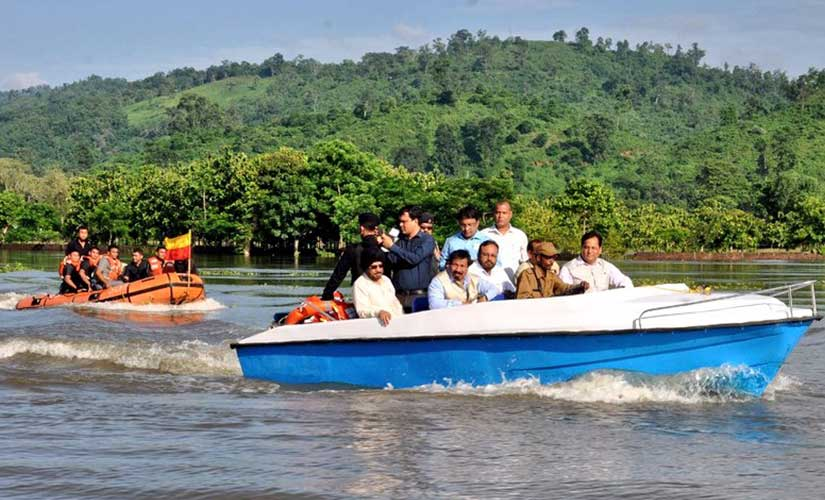 Assam chief minister Sarbananda Sonowal taking stock of the situation at the flood-hit Kaziranga National Park on 12 July. Image courtesy Sonowal's Twitter handle