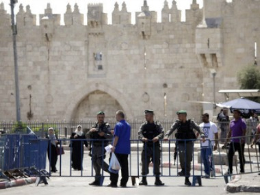 Israeli border police officers stand guard outside the Damascus Gate in Jerusalem's Old City. AP