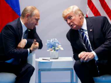 President Donald Trump meets with Russian president Vladimir Putin at the G20 Summit. AP
