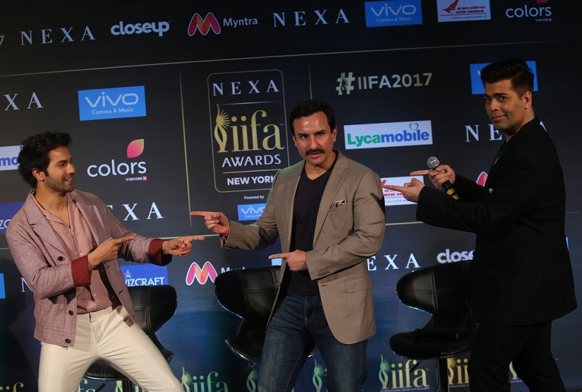 Varun Dhawan, Saif Ali Khan and Karan Johar at an IIFA press conference in Mumbai.