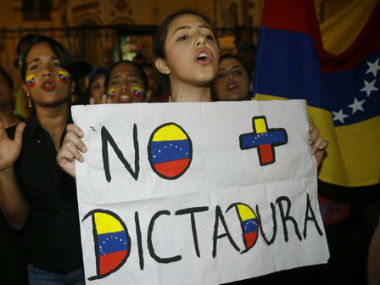 File image of a citizen protesting against the Venezuela government. AP