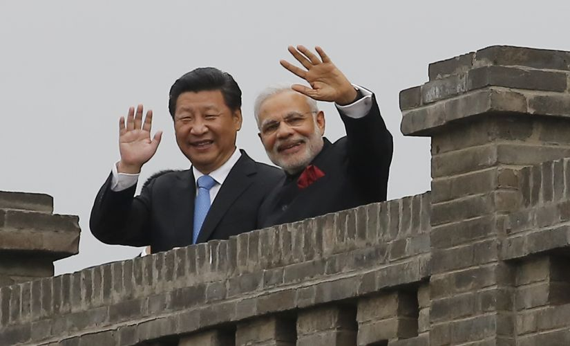 "Reporters pored over the photo to ferret out the ""more than thousand"" words that supposedly lurked behind the smiles of Modi and Xi, but they found none. Getty Images"