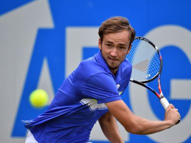 Russia's Daniil Medvedev returns during his men's singles second round match against Australia's Thanasi Kokkinakis at the ATP Aegon Championships tennis tournament at the Queen's Club in west London on June 22, 2017. / AFP PHOTO / GLYN KIRK