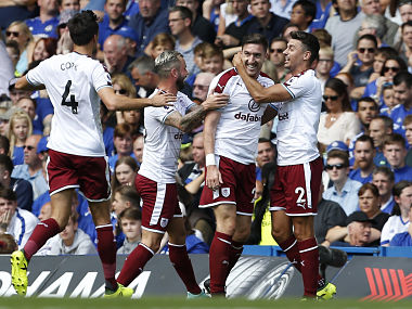 Burnley's Stephen Ward celebrates with teammates after scoring their second goal during their English Premier League match against Chelsea. AFP