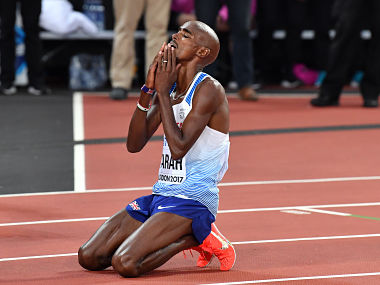 Britain's Mo Farah reacts after finishing second to take silver in the final of the men's 5000m athletics event at the 2017 IAAF World Championships at the London Stadium in London on August 12, 2017. / AFP PHOTO / Andrej ISAKOVIC