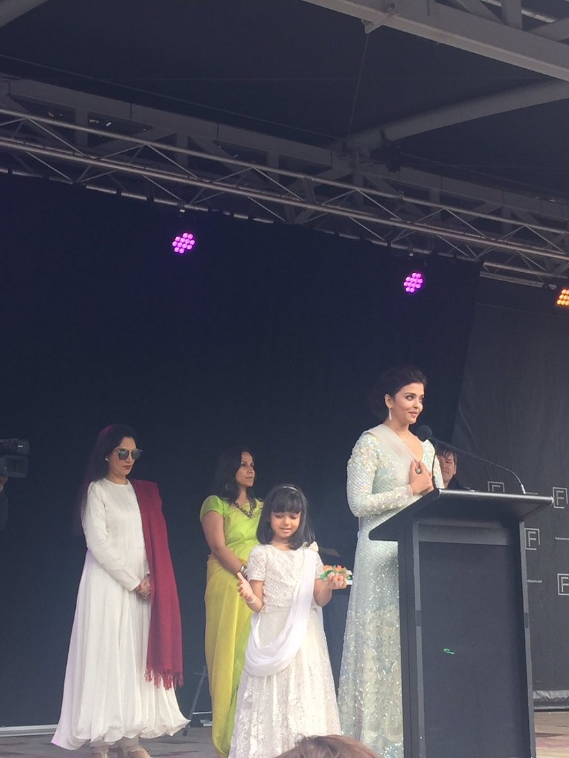 Aishwarya Rai along with daughter Aaradhya as the actor gives a speech. Image from Twitter.