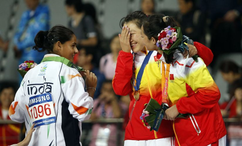 File photo of India's bronze medallist Rani Annu (L) posing with China's gold medallist Zhang Li (C) and silver medallist Li Lingwei during the medal ceremony for the women's javelin throw at the 17th Asian Games. Reuters
