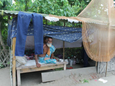An elderly person living in an embankment in Chirang district. Image courtesy Aftaf Ali