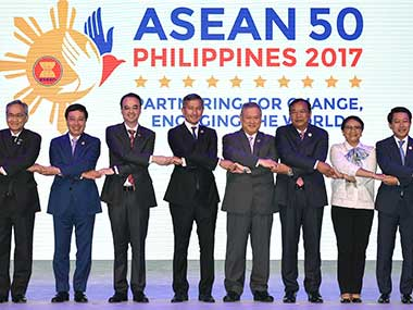 "ASEAN Foreign Ministers link hands ""The ASEAN Way"" at the opening ceremony of the 50th ASEAN Foreign Ministers Meeting at the Philippine International Convention Center on Saturday. AP"