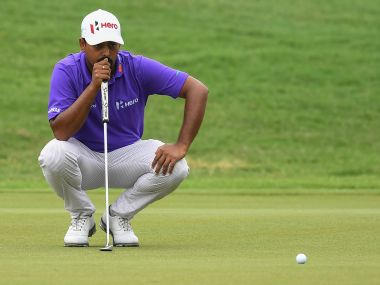 Anirban Lahiri of India lines up a putt during the third round of 2016 CIMB Classic golf tournament in Kuala Lumpur on October 22, 2016. / AFP PHOTO / MOHD RASFAN