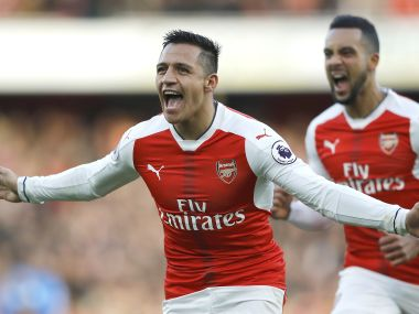 FILE - This is a Sunday, Nov. 27, 2016 file photo of Arsenal's Alexis Sanchez, left, and Arsenal's Theo Walcott celebrates after scoring during the English Premier League soccer match between Arsenal and Bournemouth at Emirates stadium in London. Alexis Sanchez is set to return to Arsenal's team for the Premier League match at Liverpool on Sunday, Aug. 27, 2017. (AP Photo/Frank Augstein FILE)