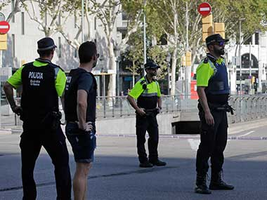 Police officers cordon off a street in Barcelona, Spain. AP