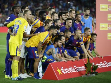 FC Barcelona's players pose with the trophy after winning the Joan Gamper trophy after a friendly soccer match between FC Barcelona and Chapecoense at the Camp Nou stadium in Barcelona, Spain, Monday, Aug. 7, 2017. (AP Photo/Manu Fernandez)