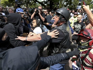 Anti and pro-Donald Trump supporters clash during competing demonstrations at Martin Luther King Jr Civic Center Park in Berkeley. AP