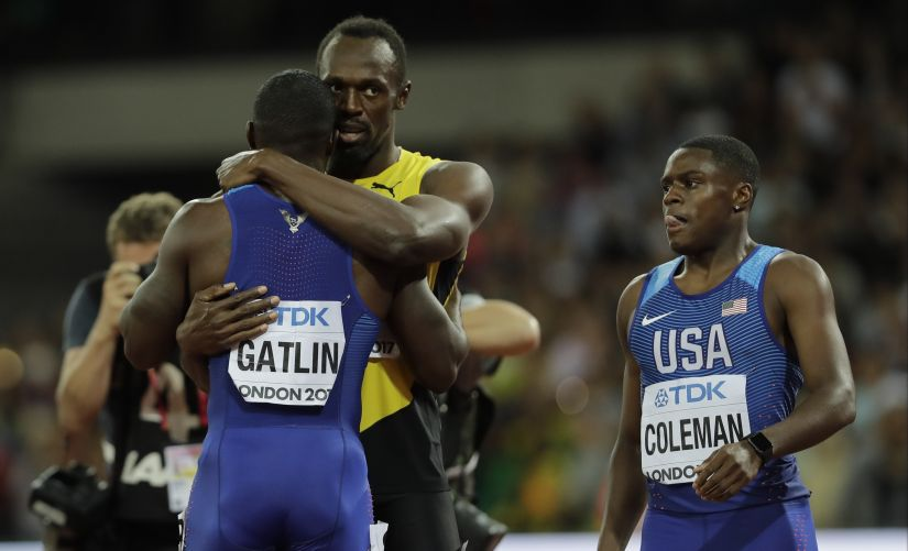 Usain Bolt, bronze, embraces gold medal winner Justin Gatlin as Christian Coleman who took the silver looks on after the men's 100m final during the World Athletics Championships. AP