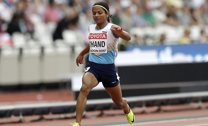 India's Dutee Chand crosses the line a women's 100m heat. AP